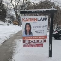real estate lawn sign sold over asking